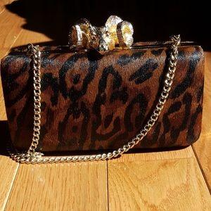 C. Wonder leopard pony hair clutch